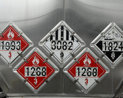 USDOT Hazardous Materials Transportation Placards on the rear of a fuel tanker.